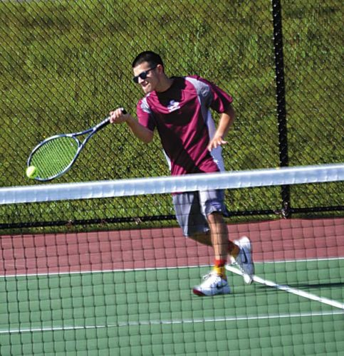 Gloversville's Brian Hugo hits a return during his second singles match with Scotia-Glenville's Brendon McCarthy in Tuesday's Section II Class A semifinal match at Knox Field in Johnstown. (The Leader-Herald/Paul Wager)