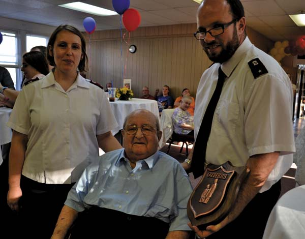 Lt. Ann Marie Devanney, left and Envoy Mark Devanney, right, of the Salvation Army of Fulton County, present longtime volunteer Robert Perrella with the Others Award for his service to the community.  (The Leader-Herald/Kerry Minor)