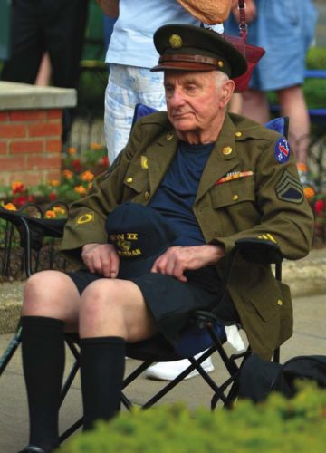 World War II Army Staff Sgt. Joe Hanchar will be the grand marshal of Friday night's Memorial Day parade in  Johnstown. This photo was taken last year while Joe  attended the  memorial service at the Charles Jenner Memorial  bandshell  in Johnstown Park.  (Photo by Bill Trojan The Leader-Herald)
