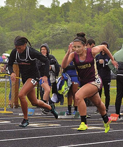 The Leader-Herald/James A. Ellis Fonda-Fultonville's Brittany Castelluccio and Mechanicville's Jada Brown break from the line during the finals of the 100-meter dash at the Section II Group 4 championships Thursday at Fonda-Fultonville High School.