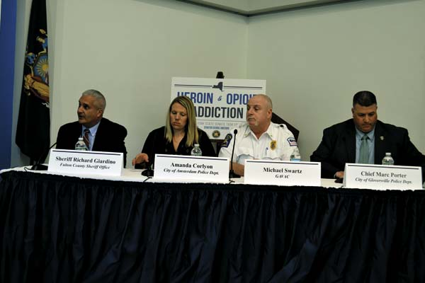 The Leader-Herald/Kerry Minor Fulton County Sheriff Richard Giardino, Amsterdam City Police Det. Amanda Corlyon, Greater Amsterdam Volunteer Ambulance Corps Operations Manager Michael Swartz and Gloversville City Police Chief Marc Porter testify before the New York State Task Force on Heroin and Opioid Addiction at Fulton-Montgomery Community College on Wednesday. (The Leader-Herald/Kerry Minor)