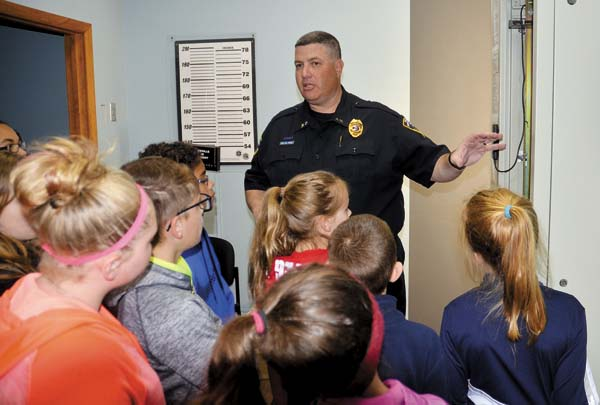 Gloversville Police Chief Marc Porter speaks to GESD fifth-graders at the Gloversville Police Department during Career Day put on by the GESD, Gloversville BID and the city of Gloversville on Thursday.