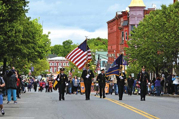 Johnstown Police Department members lead during the Johnstown Memorial Day parade on Main Street in Johnstown on Friday.
