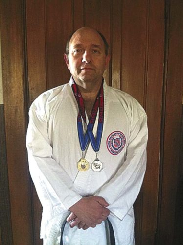 At the New York State AAU Karate Championships, Sheldon Howard, a sixth-degree black belt, returned with two medals — one gold and one silver. (Photo submitted)