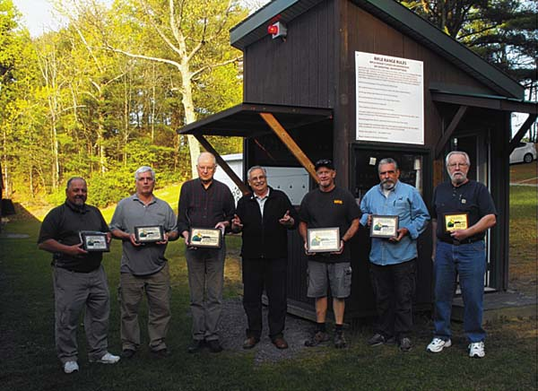 The top three finishers in each class pose for a photo at the DelSavio 100. From left, are (L to R): Ken Benton (third, benchrest), Randy Swart (second, benchrest), Harold Miller (first, benchrest), John DelSavio, Mark Duesler (first, sporter), Doug Sterling (second, sporter), and John Quackenbush (third, sporter). (Photo contributed by John DelSavio)