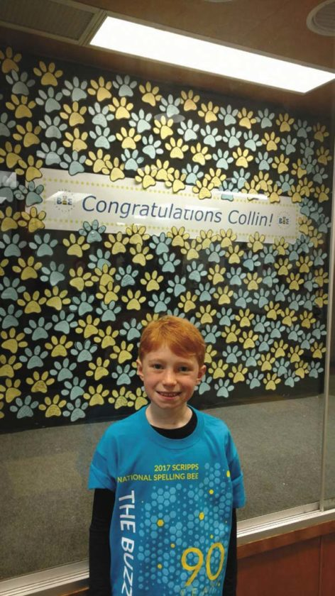Collin Shea stands in front of a display made for him by students at Mayfield Elementary School. (Photo submitted)