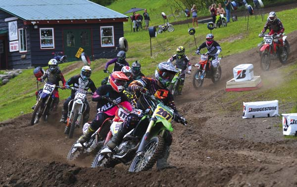 Justin Veverka (207) leads the pack during a plus-25 amateur moto Sunday at Royal Mountain Ski Area in Caroga Lake. (The Leader-Herald/Paul Wager)