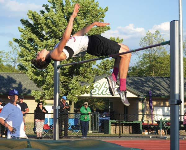 Fort Plain/Oppenheim-Ephratah/St. Johnsville's Tyler Brado clears the high jump bar at 6-03 en route to winning the Section II, D-2 championship Thursday at Shenendehowa High School. (The Leader-Herald/James A. Ellis)