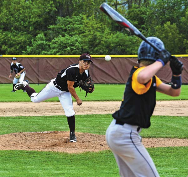 Fort Plain's Drew Fureno throws to Salem's Blake Baylor during a Section II Class D quarterfinal game May 19. Fureno recently was named Western Athletic Conference Mohawk Division Most Valuable Player. He shared the award with Galway's Sam Uline. (The Leader-Herald/Bill Trojan)