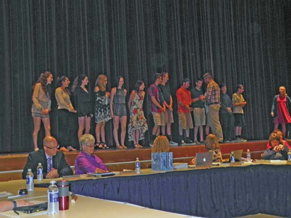 Scholar athletes are recognized on stage during the Greater Johnstown School District Board of Education meeting Thursday night at Johnstown High School. (The Leader-Herald/Michael Anich)