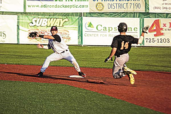 Amsterdam Mohawks' shortstop Eric Rivera looks to tag Saugerties' Nick Campana on an attempted steal in the third inning of Monday's Perfect Game Collegiate Baseball League game at Shuttleworth Park in Amsterdam. (The Leader-Herald/James A. Ellis)