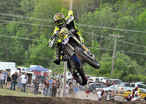 Gloversville's Salvatore Attigiato launches off the table top during a 122-250 Amateur moto at STR/Monster Supercross action Wednesday night at Royal Mountain. (The Leader-Herald/James A. Ellis)