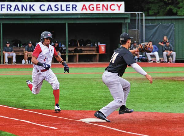 Amsterdam's Will Holland, left, attempts to beat the throw to first as Saugerties first baseman Jack Gonzalez awaits the throw during Friday's Perfect Game Collegiate Baseball League game at Shuttleworth Park in Amsterdam. (The Leader-Herald/Bill Trojan)