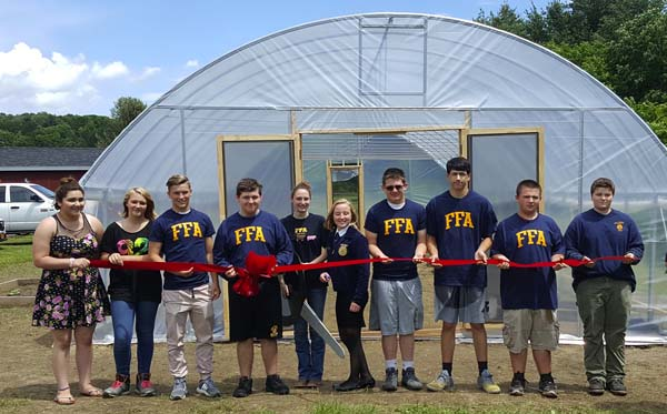 With support of the school district staff, students and volunteers, the project began this spring. The high tunnel now has cucumbers, tomatoes, squash and other vegetables to be used in the cafeteria this fall. Shown above are Destini Cioffi, Sheridan Cable, Evan Wiecienski, Nate Auriemma, Katie Joyce, Hailey Briggs, Kyle Morton, Jacob Belfance, Trevor Cotter and Aiden Boulay. (Photo submitted)
