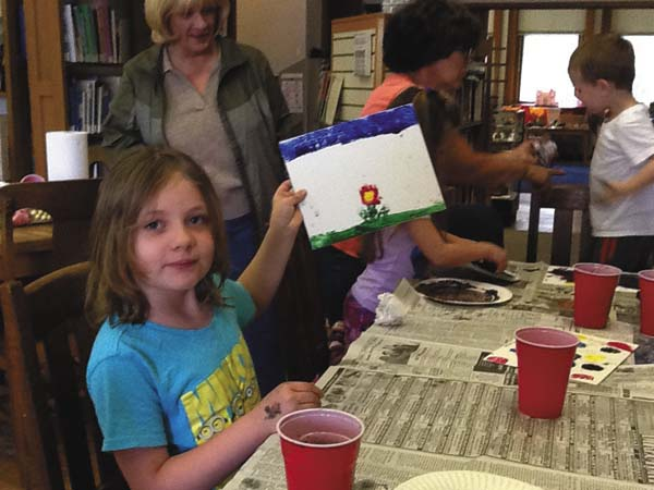 Elizabeth Miner, 7, shows  her completed painting. (Photo submitted)