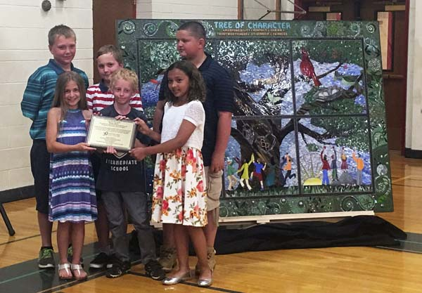 "From left, Albert Zierak, Alixandria Shrome, Ephram Harvey, Tyler Frederick, Gabriella Sanchez and Gavin Quist are shown with a ""Tree of Character"" mosaic created by the Broadalbin-Perth class of 2024. (Photo submitted)"