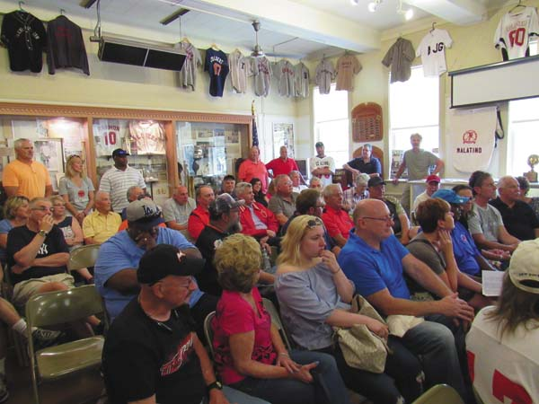 Members of the former Glove Cities Colonials football team and other interested people listen to presentations at a team reunion Saturday at the Fulton County Historical Society. (The Leader-Herald/Eric Retzlaff)