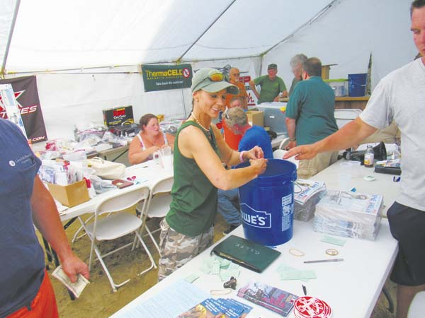 Rachel Vickers of Perth collects raffle tickets at the 26th annual Summer Fishing Contest sponsored by Great Sacandaga Lake Fisheries Federation Saturday at the lake. (The Leader-Herald/Eric Retzlaff)