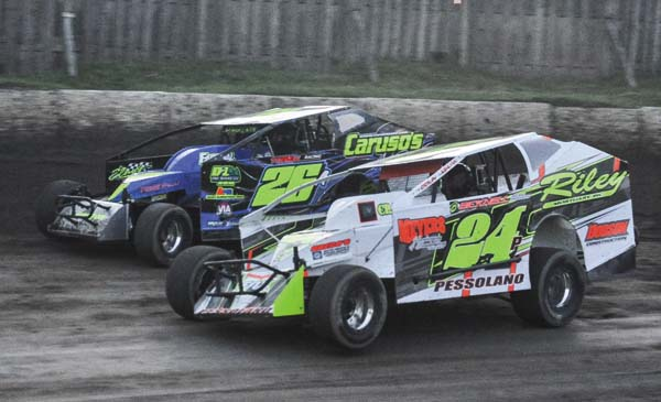 Brian Pessolano (24P) and Aaron Burton race through turns one and two during sportsman action at Fonda Speedway on Saturday. (The Leader-Herald/James A. Ellis)