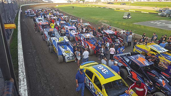 Cars line the frontstretch during a meet-and-greet session for fans to get autographs from drivers at Fonda Speedway on Saturday. (The Leader-Herald/James A. Ellis)