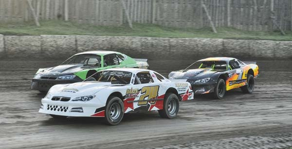 Jason Samrov (24V), Jim Normoyle, right, and Dennis Joslin race through turns one and two during pro stock action at Fonda Speedway on Saturday. (The Leader-Herald/James A. Ellis)