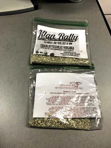 At right are the Klu Klux Klan rally flyers in plastic baggies with kitty litter to keep them from blowing away were distributed in Northville and Mayfield this past weekend.  (Photo source: Fulton County Sheriff Department's                Facebook page)