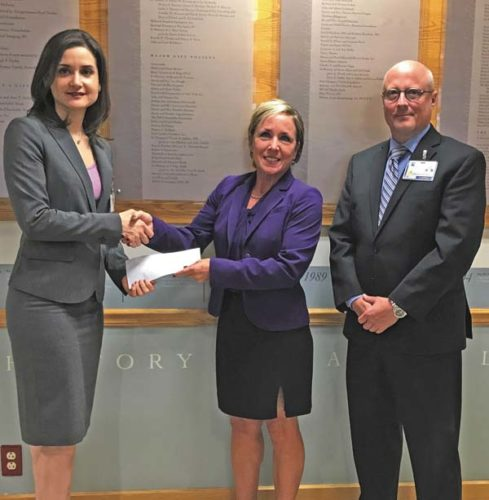 Dr. Irina Gelman, director of public health for the Fulton County Public Health Department, left,  receives an $80,000 Innovation Grant check from Nancy Greensleeve, executive director of community assessment and prevention of the Adirondack Health Institute in Glens Falls, and Geoffrey Peck of Nathan Littauer Hospital and Nursing Home, who is the Fulton County Region Population Health Network leader. The funds will be used to expand the county's telehealth program after its pilot project is completed. (Photo submitted)