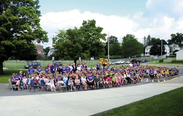 A group photo during the 50th year birthday celebration of the school out front of the school on Tuesday. The Glebe Street school building was built in 1967. (The Leader-Herald/Bill Trojan)