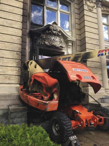 A manlift is seen blocking the door to the Amsterdam library. It started a fire Wednesday morning which was quickly extinguished keeping damage to a minimum.  (Photo submitted)