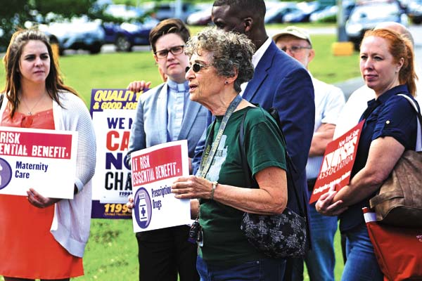 """Concerned area resident Rosemarie Sheperd of Johnstown speaks during a """"Protect Patients and Hospitals"""" event outside Nathan Littauer Hospital in Gloversville on Wednesday. (The Leader-Herald/Bill Trojan)"""