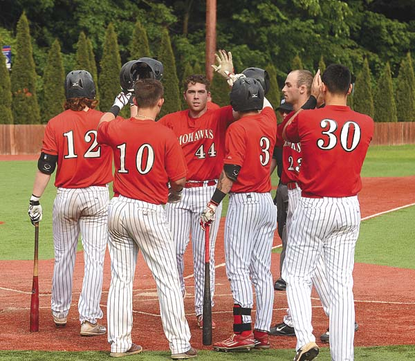 Amsterdam's TJ Collett (44) is greeted by teammates as he crosses home plate following his three-run home run in the second inning of the opening game of Friday's Perfect Game Collegiate Baseball League doubleheader against the Saugerties Stallions at Shuttleworth Park in Amsterdam. (The Leader-Herald/James A. Ellis)