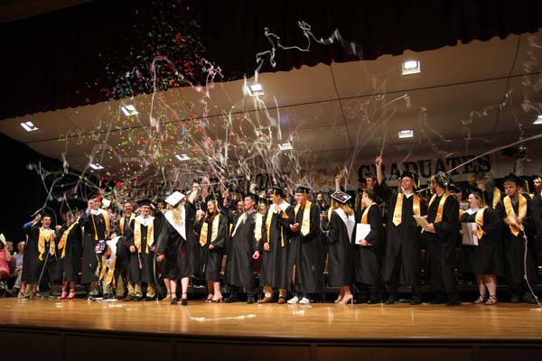 Graduating Class of 2017 at Canajoharie spray silly string to celebrate graduating. (Shawna Fleck/Fort The Leader-Herald)