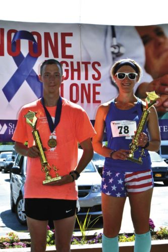 Amsterdam's Cody Russell, left, won the Lexington Run on June 10 in Johnstown. Russell finished the 3.1-mile course in a time of 18:26. The Lexington Run was the third and final race in the 5K Triple Crown presented by St. Mary's Healthcare. The first race took place May 6 with the Run for the Roses 5K in Johnstown and the second took place May 20 the Mountain Valley Hospice 5K at Fulton-Montgomery Community College. Broadalbin's Ashley Wilson, right, was the top female finisher in the Lexington Run, placing fifth overall with a time of 20:02. (Photo submitted)