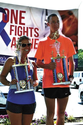 Amsterdam's Cody Russell, right, and Fort Plain's Stacy Merchant were the men's and women's winners in the 5K Triple Crown. (Photo submitted)