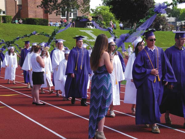 Johnstown High School class of 2017 graduates file into commencement Saturday at Knox Field. (The Leader-Herald/Michael Anich)