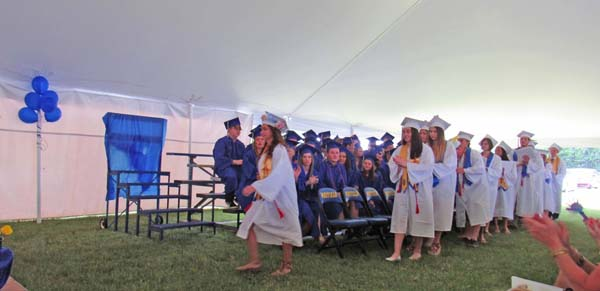 Seniors step forward to receive their diplomas at the Mayfield High School graduation Saturday. (The Leader-Herald/Eric Retzlaff)