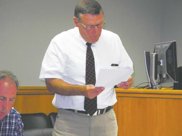 Johnstown Councilman-at-Large Craig Talarico reads a resolution approving Greenman Pedersen Inc. as consulting engineers for a city bridge project Monday night at City Hall. (The Leader-Herald/Michael Anich)