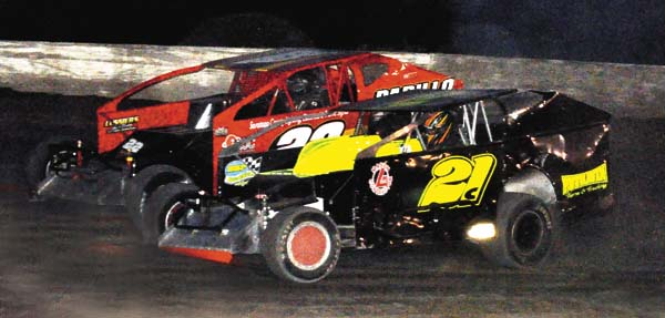 Tim Hartman Jr. challenges Brian Calabrese (21C) for the lead in the 30-lap Crate Modified feature Sunday night at Glen Ridge Motorsports Park. (The Leader-Herald/James A. Ellis)