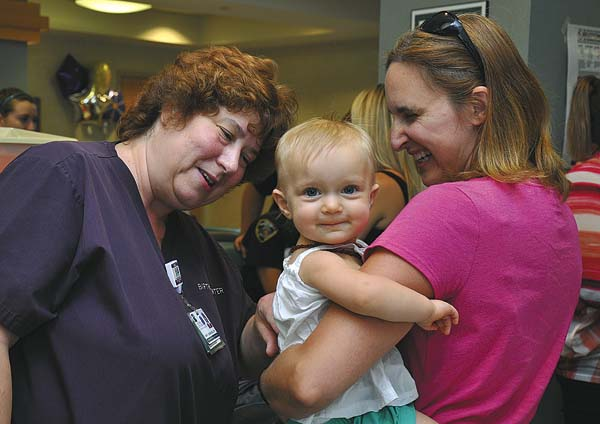 At left, Nancy Quinlan, registered nurse and lactation specialist with Nathan Littauer Hospital and Nursing Home, talks with Erin Fioretti, who is holding her daughter Violet, during a Littauer breastfeeding event. (Photo submitted)