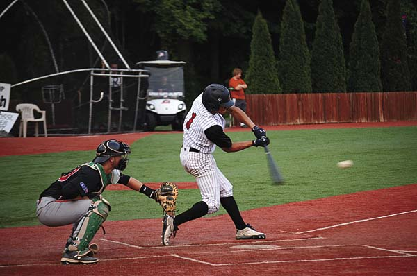 Amsterdam's Will Holland connects for an RBI single in the Mohawks' four-run fifth inning against the Glens Falls Dragons in Perfect Game Collegiate Baseball League action Thursday at Shuttleworth Park. (The Leader-Herald/James A. Ellis)