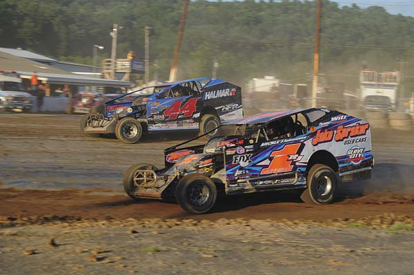Ronnie Johnson (2RJ) races through turns three and four with Stewart Friesen (44) during modified action Saturday at Fonda Speedway. (The Leader-Herald/James A. Ellis)