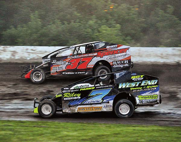 David Constantino (7) challenges Chad Edwards for the lead on the low side of turns one and two during the 602 modified feature Sunday night at Glen Ridge Motorsports Park. (The Leader-Herald/James A. Ellis)