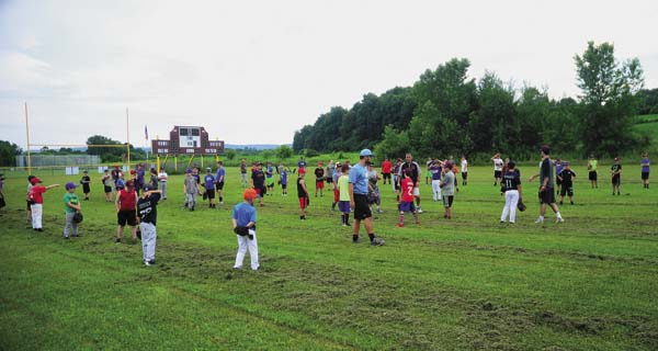 An overview of campers working on skill development during the annual FFCS Baseball Camp held at the F-F Little League Park in Fonda on Monday. (The Leader-Herald/Bill Trojan)