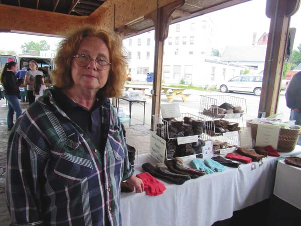 Linda Horlbeck of Merry Hill Farm in Amsterdam said she was happy with sales of her alpaca knitted items at the Gloversville Twilight Market Friday at the Farmers Market Pavilion. (The Leader-Herald/Eric Retzlaff)