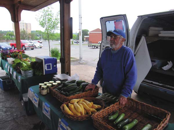 Richard Rugen of Hope Valley Farms in Hope Falls offerng vegetables and flowers for sale. (The Leader-Herald/Eric Retzlaff)