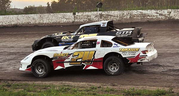 Jason Samrov (24V) and Nick Stone battle for the lead during the 20-lap Pro Stock main event Sunday night at Glen Ridge Motorsports Park. (The Leader-Herald/James A. Ellis)