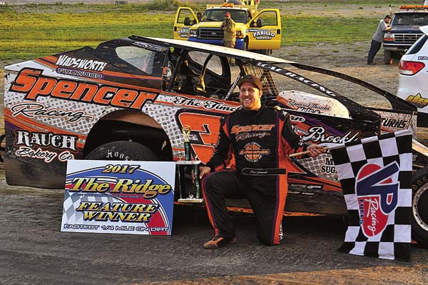 The Leader-Herald/James A. Ellis Chad Edwards celebrates in Victory Lane after claiming the 25-lap crate modified feature win Sunday at Glen Ridge Motorsports Park.