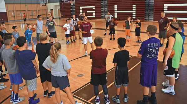 Coach Aric Kucel, center, speaks with the campers during the annual Next Level Basketball Camp Monday at Gloversville High School  (The Leader-Herald/Bill Trojan)