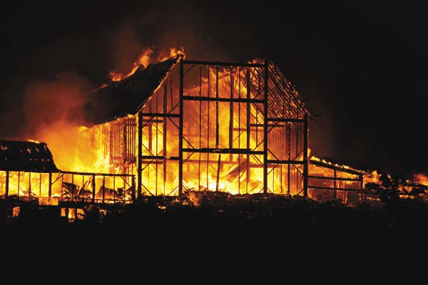 A fire rages in a barn at 280 Budnick Road in Nelliston, near the Fort Plain reservoir. Hay was reportedly on fire inside the barn with cows inside. Fort Plain responded with St. Johnsville, Canjajoharie, South Minden, and Ephratah were called for tankers. The barn was reportedly built in 1930 by Harry Berry's father. (Photo courtesy of Terry Potoczny)