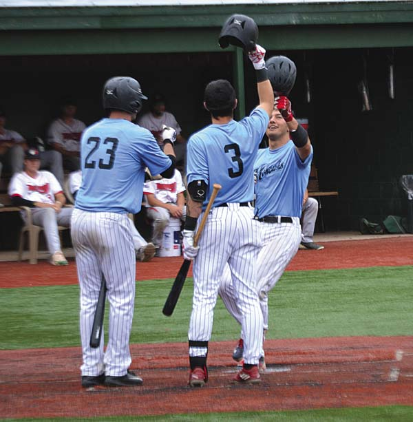 Amsterdam's Jake Mueller (23) and Eric Rivera (3) greet John Valente at home plate after Valente hit a first-inning home run during Wednesday's Perfect Game Collegiate Baseball League game against Glens Falls at Shuttleworth Park in Amsterdam. (The Leader-Herald/Paul Wager)